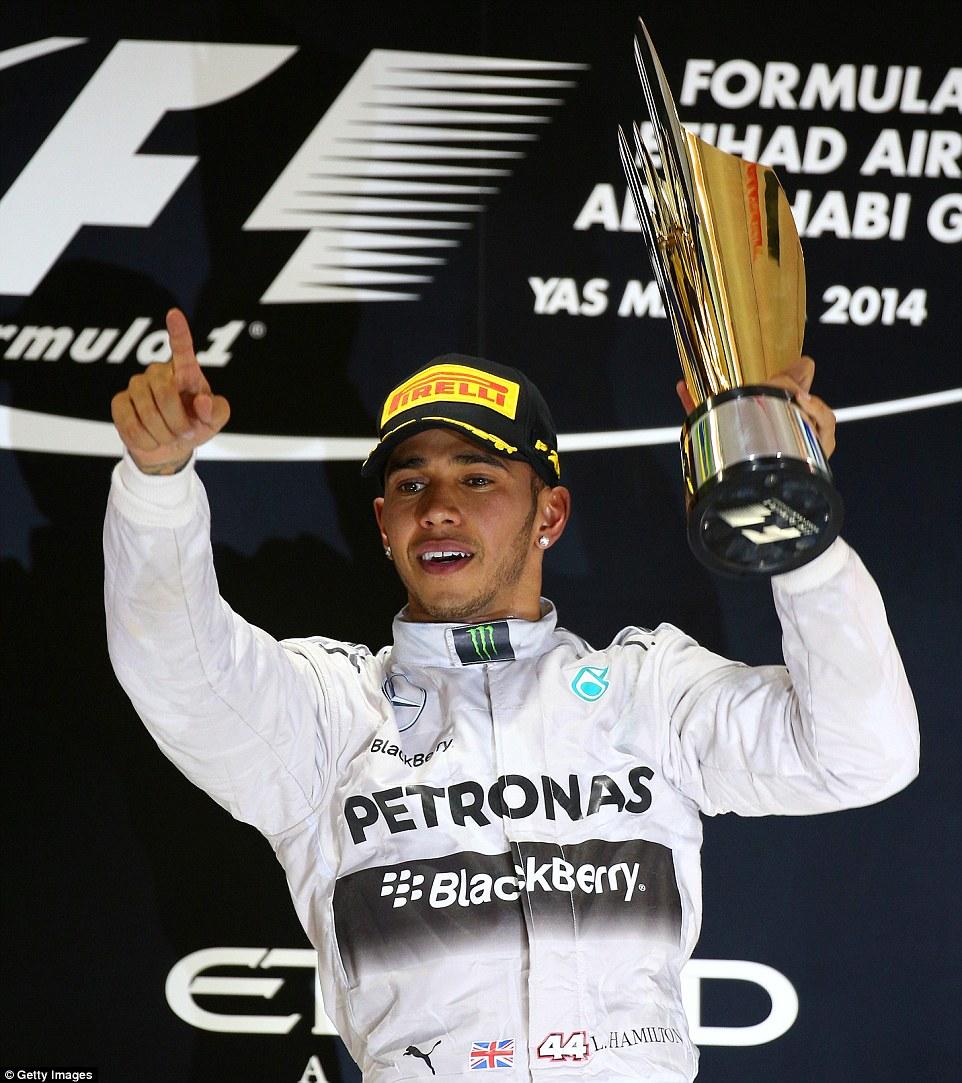 Hamilton celebrates his 2014 Formula One world championship.